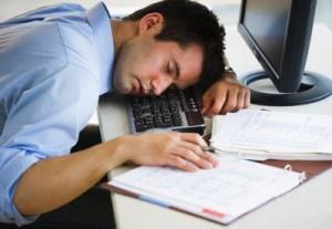 Businessman asleep at his desk --- Image by © Tetra Images/Tetra Images/Corbis